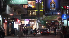 Busy Hong Kong street at night Stock Footage