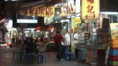 Hong Kong night market, food stall, China Stock Footage