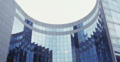 Beautiful abstract of the glass-clad facade office building Stock Footage