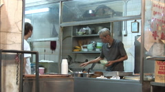 Serving soup, Hong Kong food stall, China - stock footage