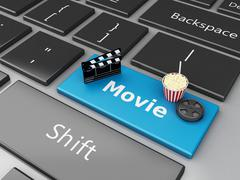 3d Popcorn,  clapper board and film reel on computer keyboard. Stock Illustration