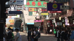 People on cross walk, Hong Kong side street - stock footage