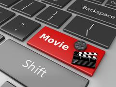 3d Clapper board and Film reel on computer keyboard. Stock Illustration