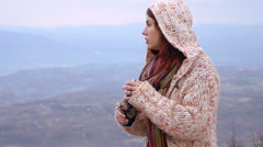 Redhead on the top of a windy hill with the ashes oh her father Stock Footage