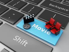 Stock Illustration of 3d Cinema Clapper board and theater seat on computer keyboard.