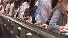 People, hands on escalator rail, Hong Kong Stock Footage