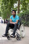 Stock Photo of young disabled indian man sitting in a wheelchair