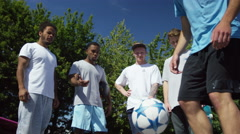 4K Talented young soccer player showing off his ball skills, hanging out with hi - stock footage