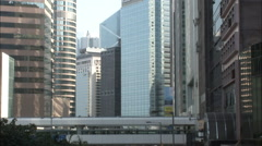 Hong Kong skywalk amongst skyscrapers Stock Footage