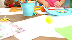 Kids playing together with arts and crafts items - stock footage