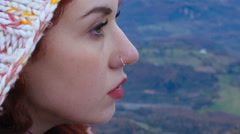 Redhead Woman meditative on the top of a mountain - stock footage