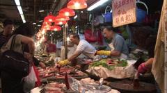 Chinese fishmongers, customers, Hong Kong Stock Footage