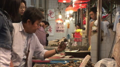 Customers in busy seafood market, Hong Kong Stock Footage