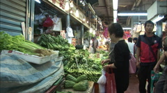 Chinese lady buying vegetables, market, HK Stock Footage