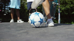 4K Talented young soccer player showing off his ball skills, hanging out with hi Stock Footage