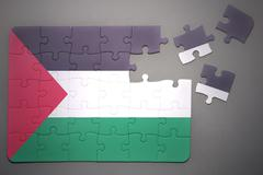 puzzle with the national flag of palestine - stock photo