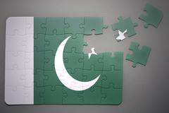 Puzzle with the national flag of pakistan Stock Photos