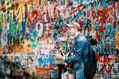 Man sings music band KINO songs near Viktor Tsoi Wall in Moscow, Russia Stock Photos