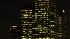 Time Lapse of London's Canary Wharf Financial District Office Windows at Night - stock footage