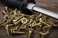 Screwdriver and screws Stock Photos