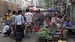 Busy Asian Market Street with Vegetables Sellers Stock Footage