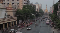 Busy Yangon Street with Sule Pagoda Evening Stock Footage