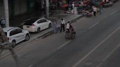 Stock Video Footage of High Angle of Rickshaw along Asian Street (Burma/Yangon)