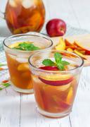 Two glasses of refreshing homemade nectarine iced tea - stock photo