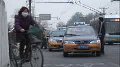 Chinese cyclist with facemask, pollution - stock footage