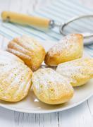 Sugar powdered madeleines on the white plate Stock Photos