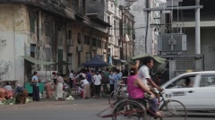 Busy Asian Street Market on Road with Traffic (Yangon/Burma) Stock Footage