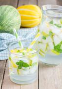 Summer cocktail from melon, mint and soda drink Stock Photos