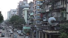 Long Street Scene Traffic and Decrepit Buildings (Yangon, Burma) Stock Footage