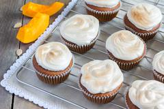 Homemade pumpkin cupcake decorated with meringue - stock photo