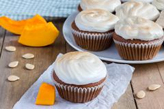 Stock Photo of Homemade pumpkin cupcakes decorated with meringue