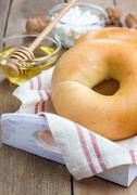 Fresh bagel for breakfast. Concept of healthy eating. Stock Photos
