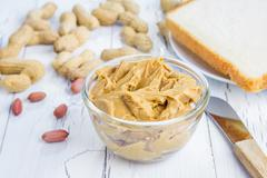 Creamy peanut butter with nuts - stock photo