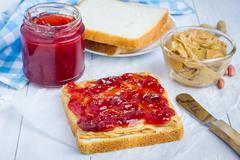 Sandwich with creamy peanut butter and strawberry jam - stock photo