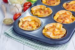 Homemade lasagna cups with minced meat, bolognese sauce topped with cheese Stock Photos