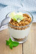 Yogurt with granola and fruits. Concept of healthy eating for breakfast. Stock Photos