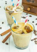 Coffee ice cubes with milk - stock photo