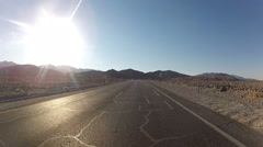 Fast Car Drive Down A Desert Country Road Stock Footage