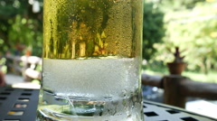 Beer bubbles with ice in glass  Stock Footage