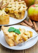 Homemade delicious apple pie with lattice pattern - stock photo
