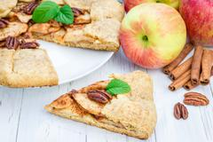 Piece of homemade fresh apple galette with pecan nuts Stock Photos
