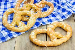 Freshly baked homemade soft pretzels sprinkling with coarse salt Stock Photos