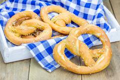 Freshly baked homemade soft pretzels sprinkled with sesame Stock Photos
