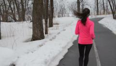 Runner Rear View Of Woman Jogging In Winter Snow - Fitness Healthy Lifestyle Arkistovideo