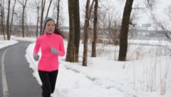 Fitness Running Young Woman Jogging In Winter Snow – Cold Weather Training Arkistovideo