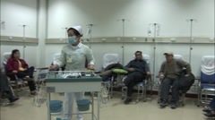 Nurse moving trolley, Chinese hospital Stock Footage